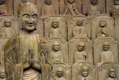 500 Rakan. Stone sculptures of standing bodhisattva and group of 500 rakan (arhats Royalty Free Stock Photography