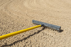 Rake in a bunker Stock Images