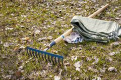 Tools for cleaning the territory on the grass. royalty free stock photos