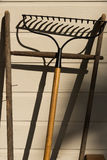 Rake leaning against wall. Stock Images