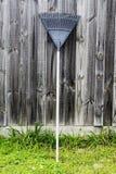 Rake raking grass clippings, garden tools Stock Photos
