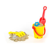 Rake, shovel and bucket with a little sand Royalty Free Stock Photography