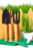 Rake, shovel, rubber gloves, pot against the fence Royalty Free Stock Photography
