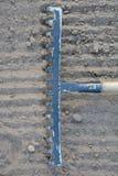 Rake on soil. Rake on loosened soil closeup Royalty Free Stock Photo