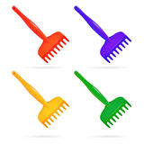Rake. Toy for child. Set of plastic rake red yellow green blue. Isolated object. Vector illustrations. Rake. Toy for child. Set of plastic rake red yellow green Royalty Free Stock Photo