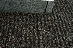 Raked Gravel. In linear patterns in a small Japanese garden Royalty Free Stock Photo