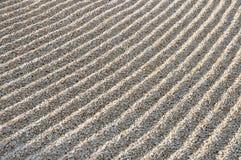 Raked Sand. A raked sand. Detail of a zen garden Stock Photos
