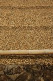 Raked sand border Stock Photo