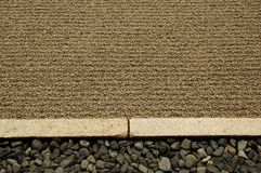 Raked sand border Royalty Free Stock Photo