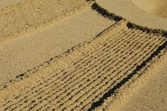 Raked sand. Detail of a Japanese raked sand garden Royalty Free Stock Photography