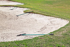 Rakes on bunker. Hole on golf course Stock Photos