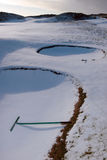 Rakes in bunkers on a snow covered golf course. Rakes in bunkers on a snow covered links golf course in ireland in snowy winter weather Stock Photography