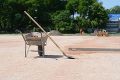 Rakes and mortar cart on construction site. Photi was taken on a construction site near football stadium Spartak Subotica, Serbia. It was a nice sunny day royalty free stock image