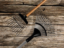 Rakes  on old wood background Stock Image