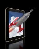 Raket die uit een Tablet vliegen Stock Afbeelding