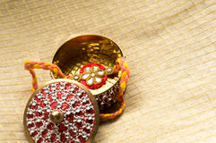 Rakhi kept in a decorated golden box Stock Photography