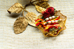 Rakhi thread with decorative gold leaves Royalty Free Stock Photo