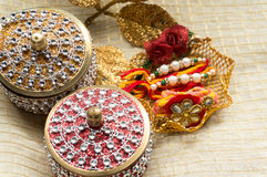 Rakhi threads with jewelled boxes Stock Photos