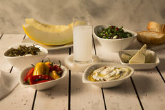 Raki served with appetizeres. On the table stock photography
