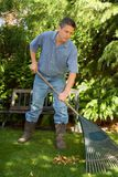 Raking gardener Royalty Free Stock Image