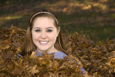 Raking Leaves Girl in Leaf Pile Royalty Free Stock Photos