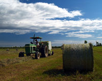 Raking Rolls of Hay 2 Stock Photo