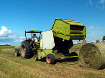 Free Raking Rolls Of Hay Stock Image - 1107411