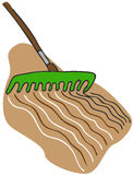 Raking Soil. An image of a rake garden tool raking the soil Stock Photo