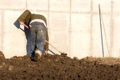 Raking the soil royalty free stock image