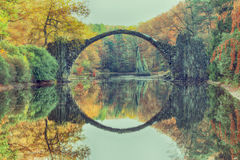 Rakotz Bridge Rakotzbrucke, Devil`s Bridge in Kromlau. Amazing Royalty Free Stock Photo