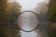 Rakotzbrücke (Devil's bridge) in early morning mist. Rakotzbrücke (Devil's bridge) in early morning mist, in autumn, Kromlau, Germany Stock Photography