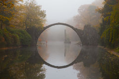 Rakotzbrücke (Devil's bridge) in early morning mist Stock Photography