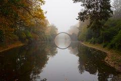 Rakotzbrücke (Devil's bridge) in early morning mist Royalty Free Stock Photo