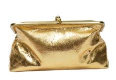 Raksträcka på skott av en stängd stående guld- metallisk mynthandväska Arkivbild