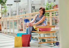 Ralaxing Woman With colored Shopping Bags Royalty Free Stock Photo
