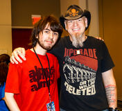 Raleigh, NC, USA - May 24, 2014: Animazement 2014. Anime convention attendee poses with singer, songwriter, and voice actor Jason Charles Miller at the Raleigh Stock Photography