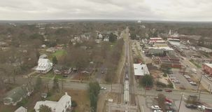 Raleigh Train passing houses and Industrial Sites stock video footage