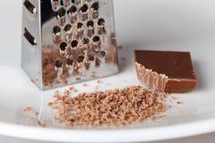 Rallador y migas del chocolate Imagen de archivo libre de regalías