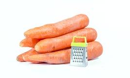 Rallador y zanahorias Fotos de archivo libres de regalías