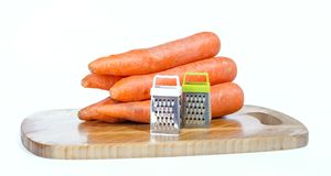 Ralladores y zanahorias Foto de archivo libre de regalías