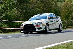 Mitsubishi Lancer Evo X tuning rally car. Rally car in action on asphalt. Mitsubishi Lancer Evo X tuning. Panning shot stock images