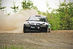 Rally car in action. With big dust on gravel Stock Image