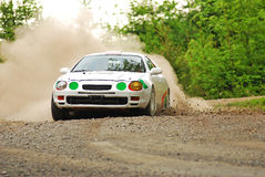 Rally car in action. With big dust on gravel Royalty Free Stock Image