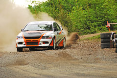 Rally car in action. With big dust on gravel Royalty Free Stock Photo