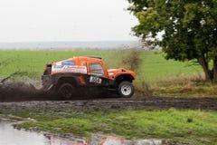 Rally car on a dirt road through the fields Stock Photos
