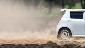 Rally car in dirt road Stock Photography