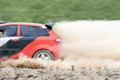 Rally car in dirt track. Rally car accelerate speed in dirt track Stock Image