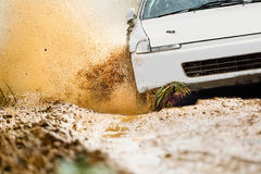 Rally Car in dirt track. Rally Car increas speed in dirt track Royalty Free Stock Photo