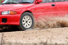 Rally car in dirt track. Red rally car in dirt track Stock Images