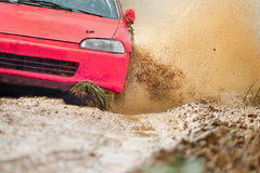 Rally car in dirt track. Red rally racing car in dirt track Stock Photo